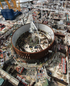 Aerial view of the metal ring of reactor 1. The area is busy with many components